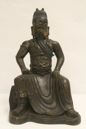 A fine Chinese bronze sculpture of seated Guandi