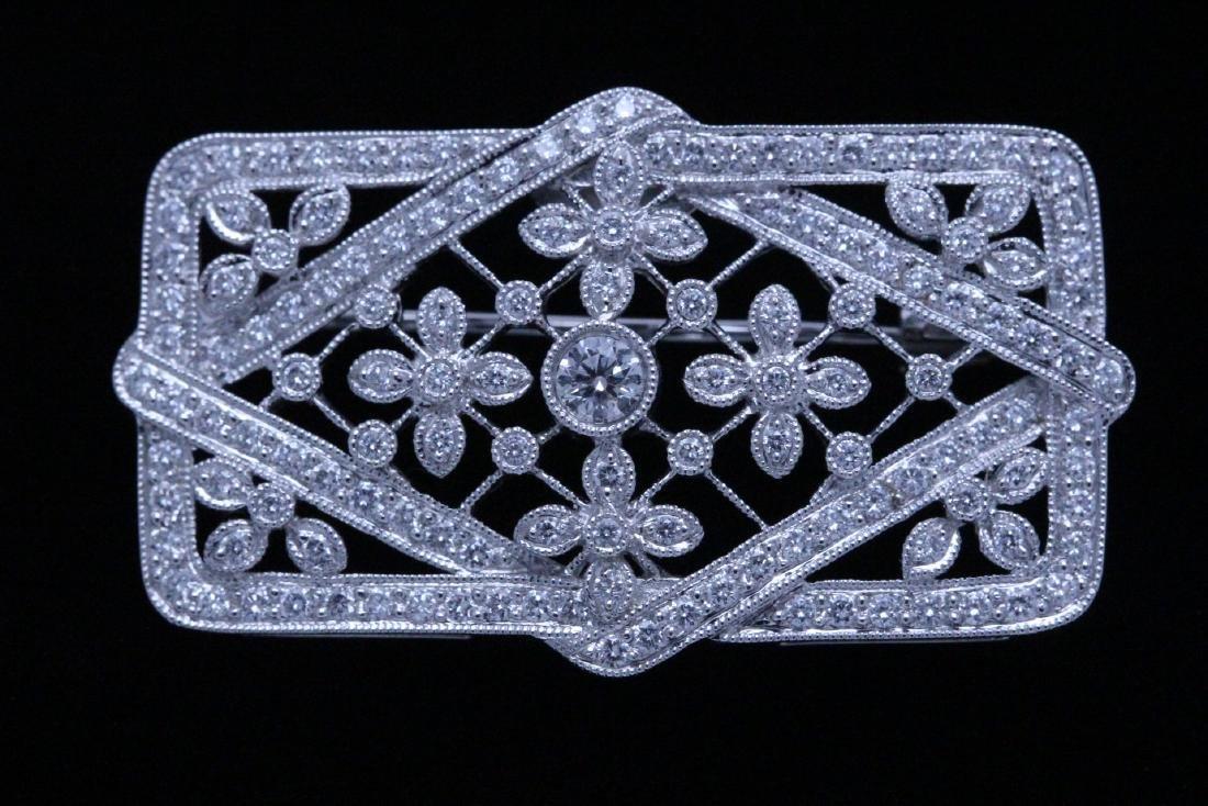 A beautiful 18K W/G filigree diamond brooch