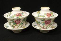 Pr porcelain covered tea cups with under-plate