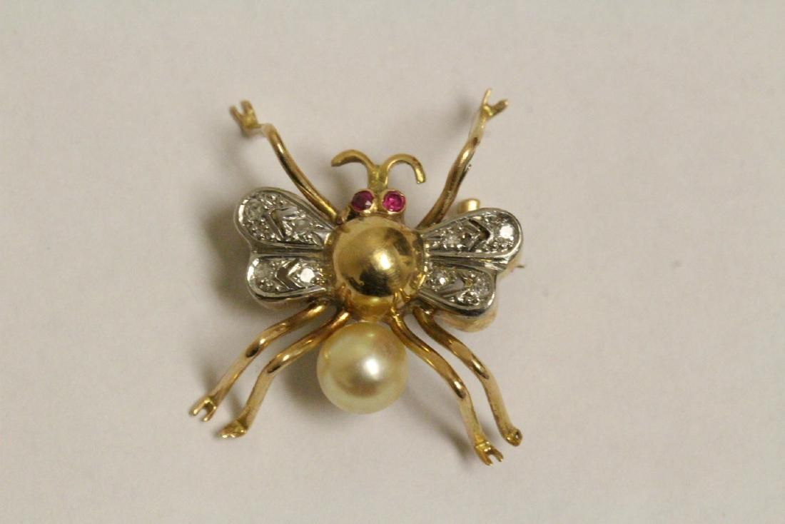 Lady's 14K brooch w/ diamond, ruby and pearl