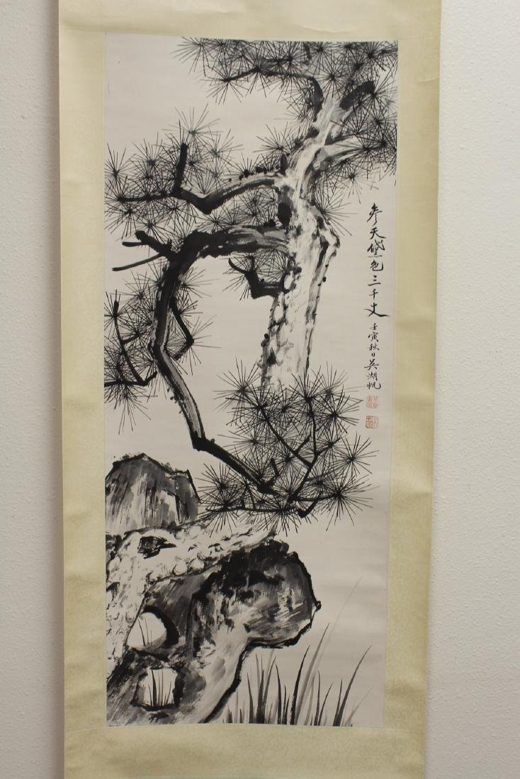 Chinese watercolor scroll depicting pine tree
