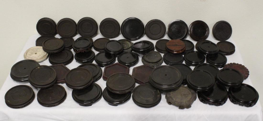 Large lot of Chinese stands, over 40 pieces