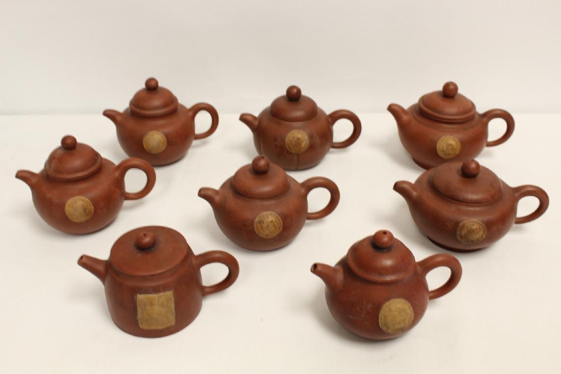 8 Yixing teapots