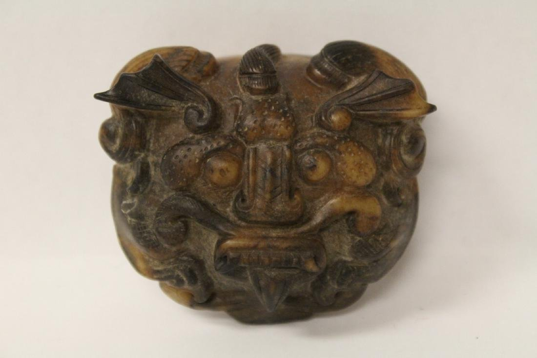 A fine Chinese jade carved belt buckle