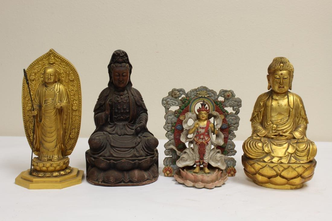 "4 ""casted"" Buddha statue"