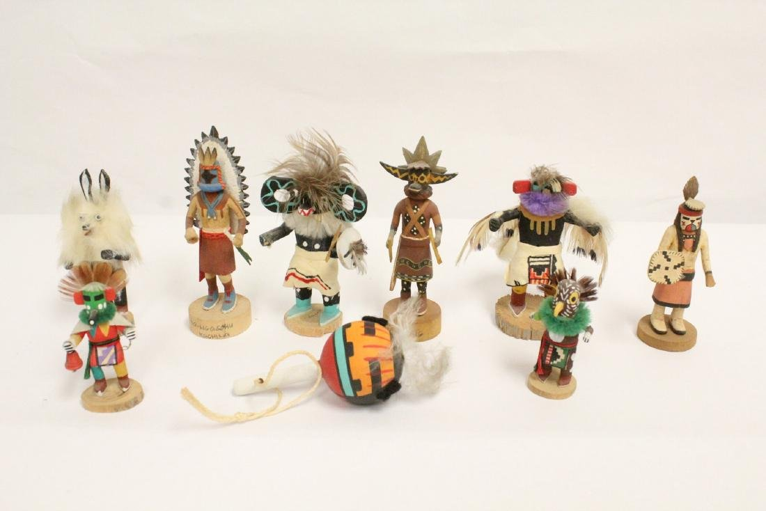 8 miniature Kachina dolls, and a painted Indian toy