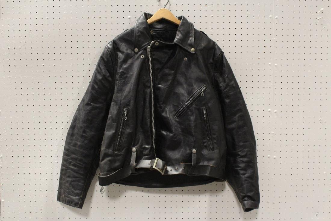 An early Harley Davidson leather jacket with belt
