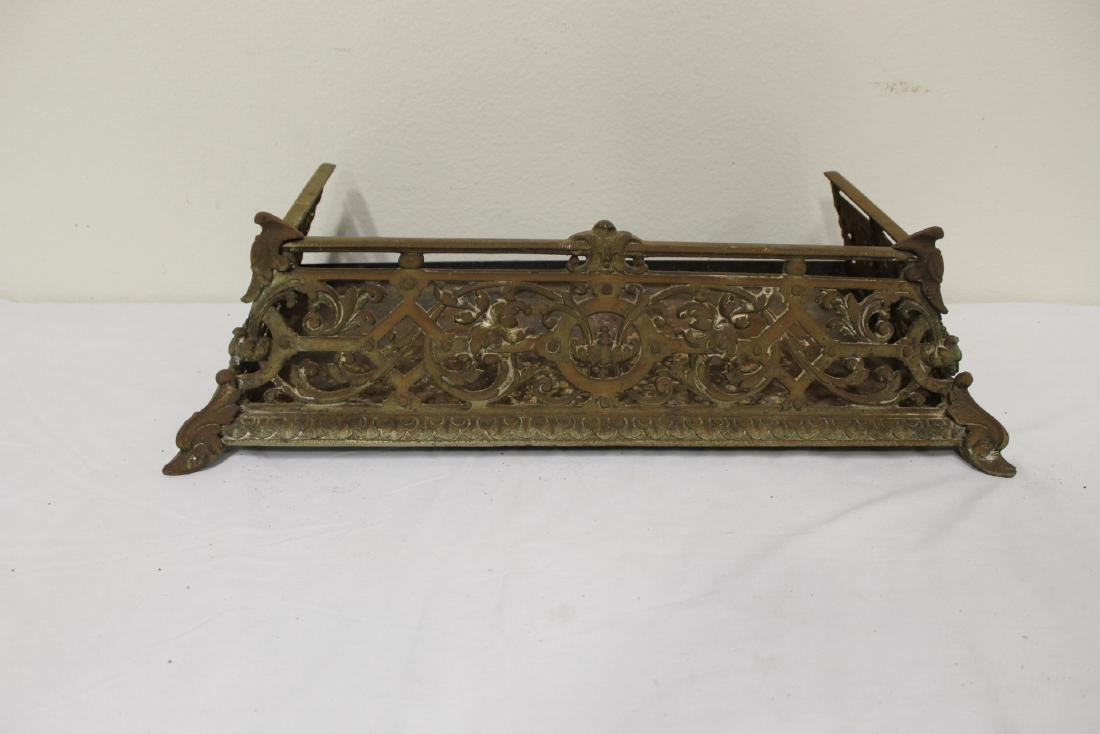 Very ornate Victorian cast iron fireplace fender