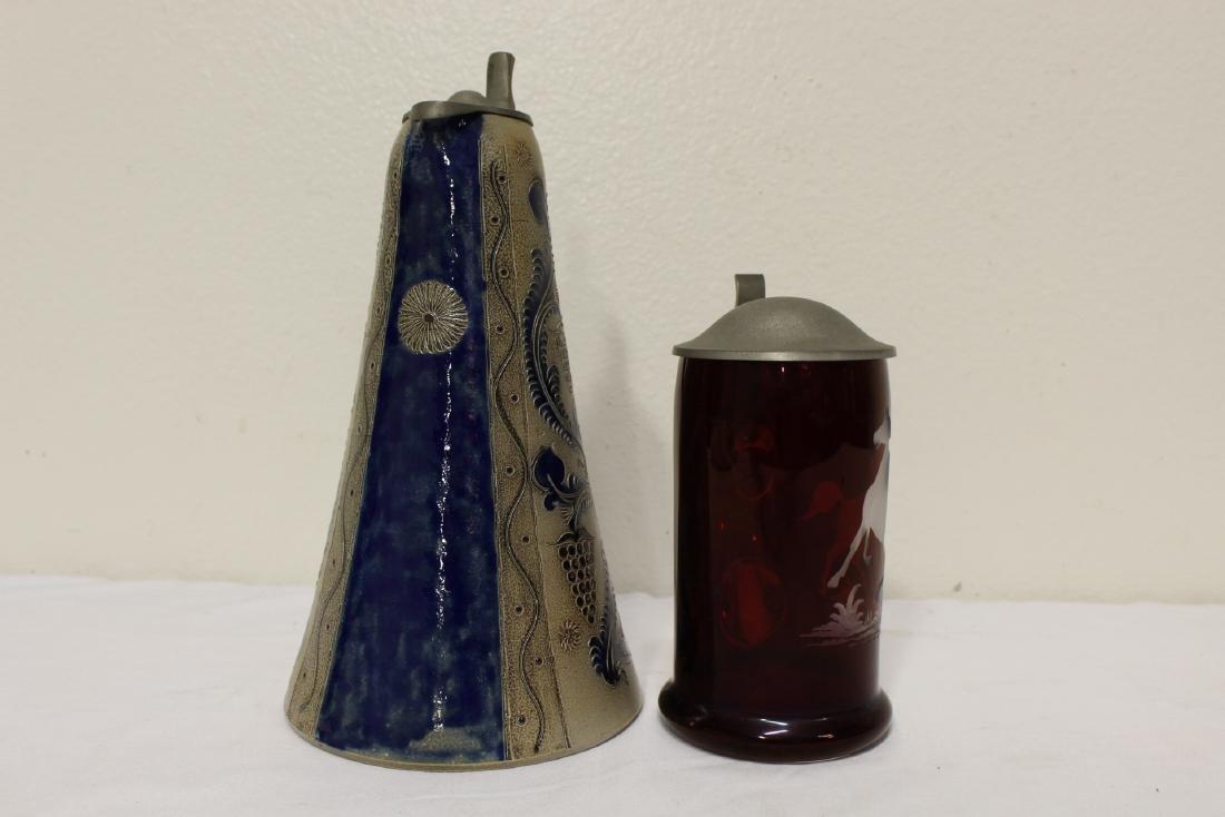2 German beer steins, one is etching ruby glass - 2