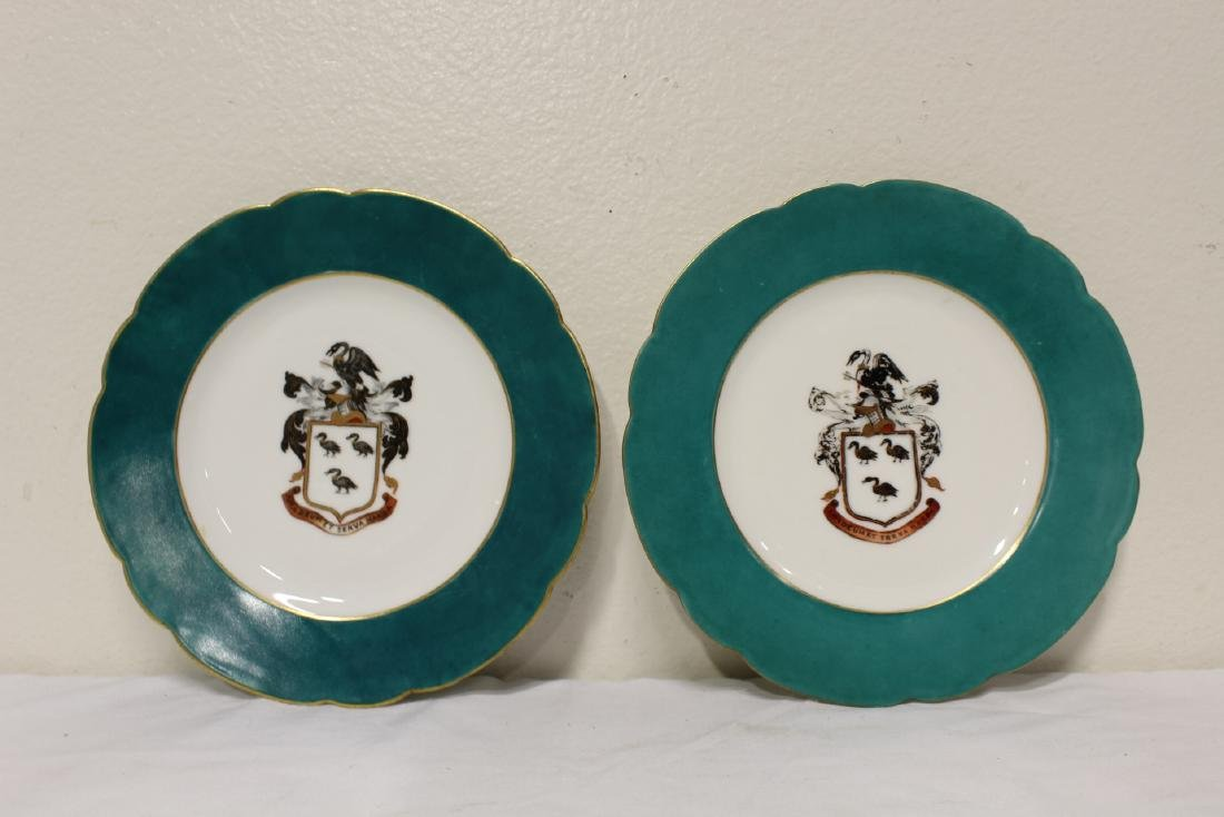 2 French porcelain plates painted with family crest
