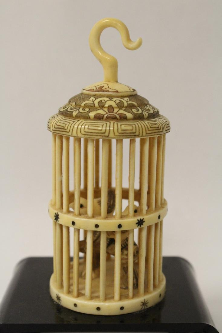 A bone carved bird cage with bird - 2