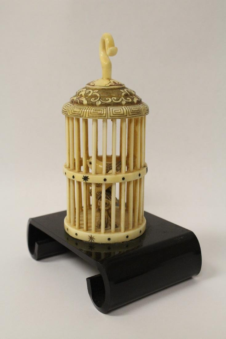 A bone carved bird cage with bird - 3