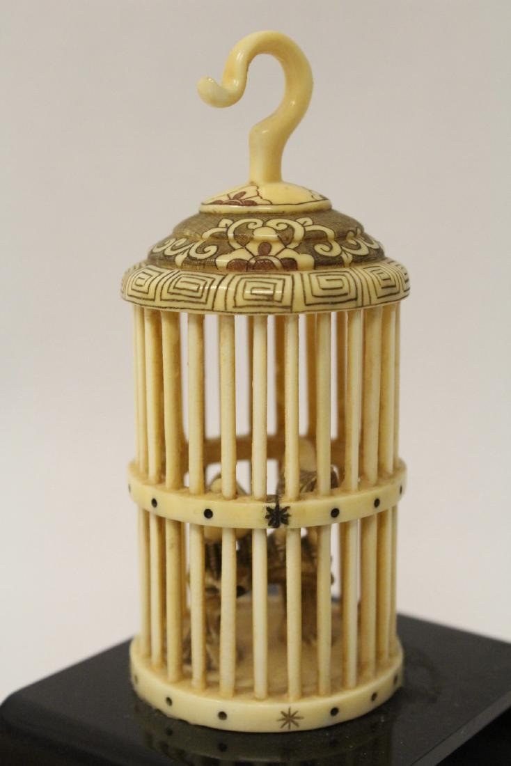 A bone carved bird cage with bird - 5