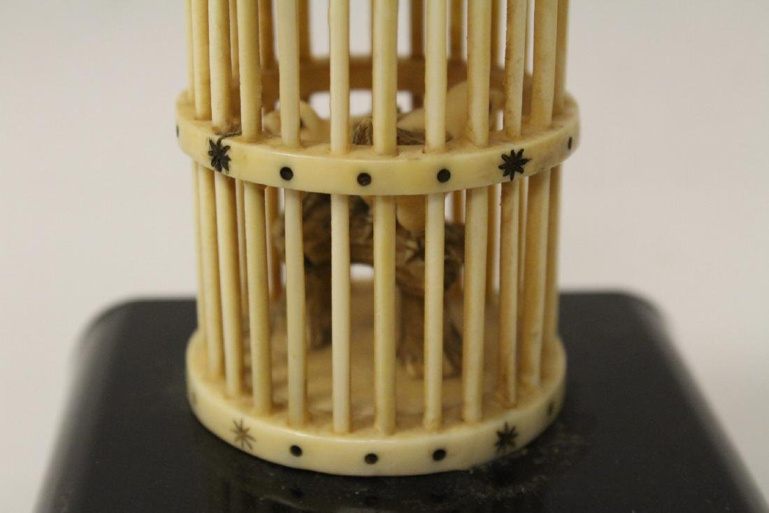 A bone carved bird cage with bird - 7