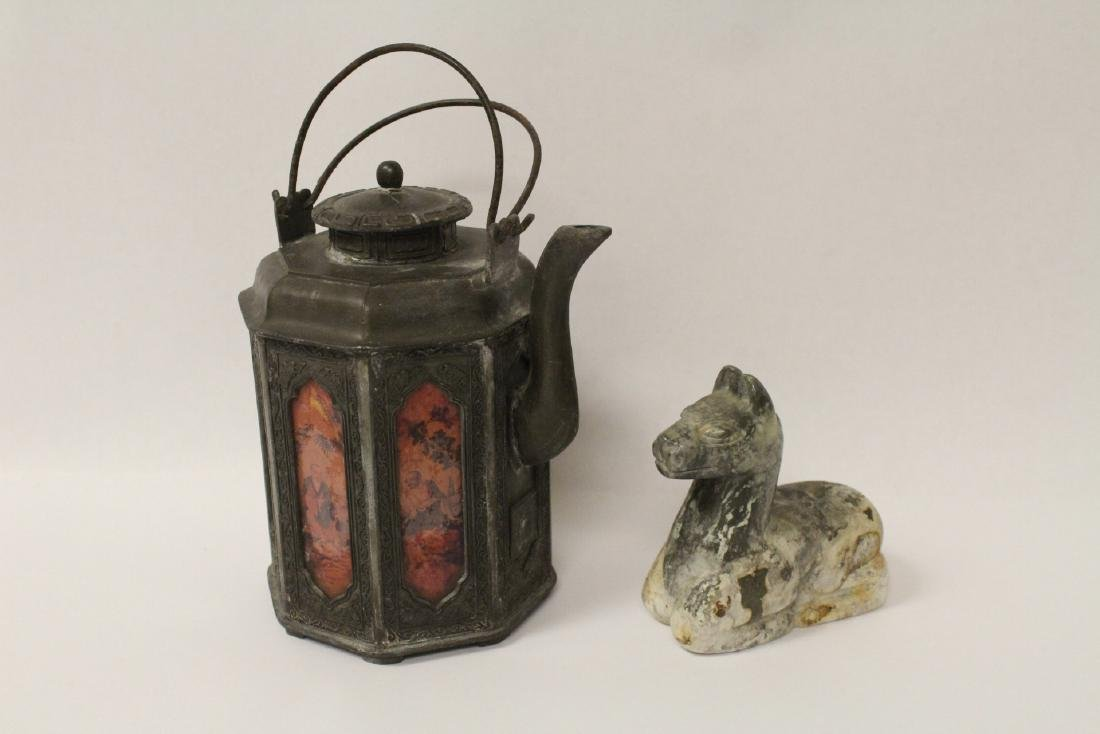 A stone carved lama and a pewter teapot