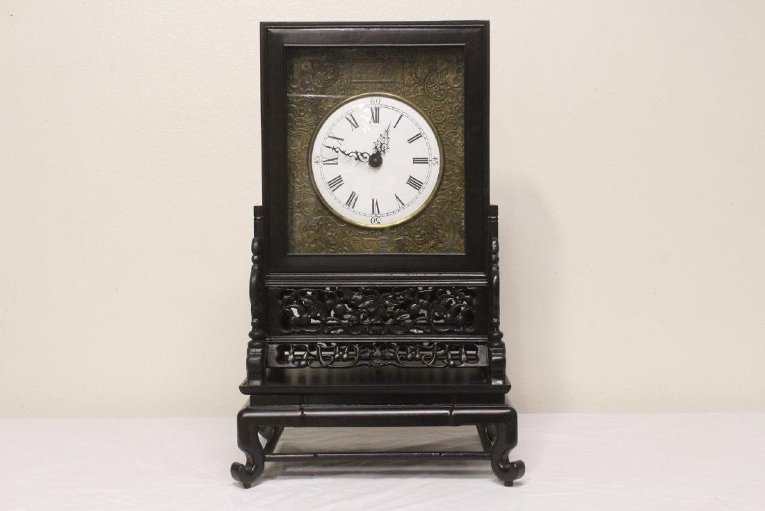 Chinese rosewood cased table clock with stand
