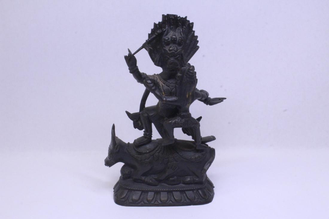A very heavy Tibetan bronze sculpture