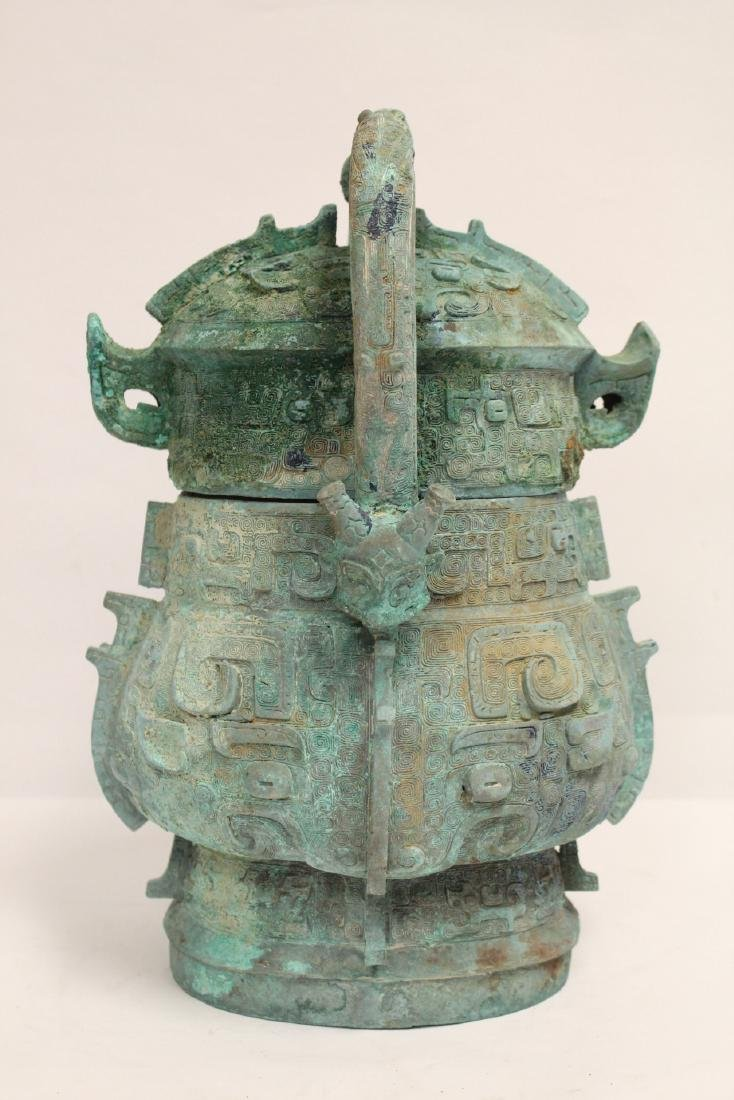 A fine Chinese archaic style bronze handled hu