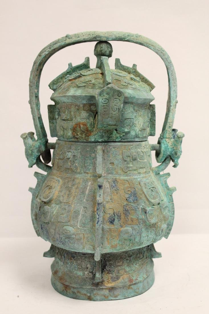 A fine Chinese archaic style bronze handled hu - 2