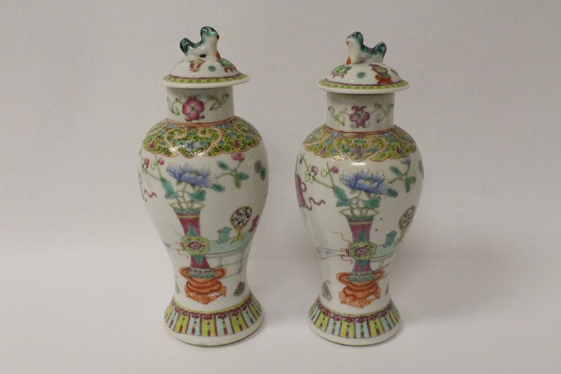 Pair famille rose porcelain covered jars