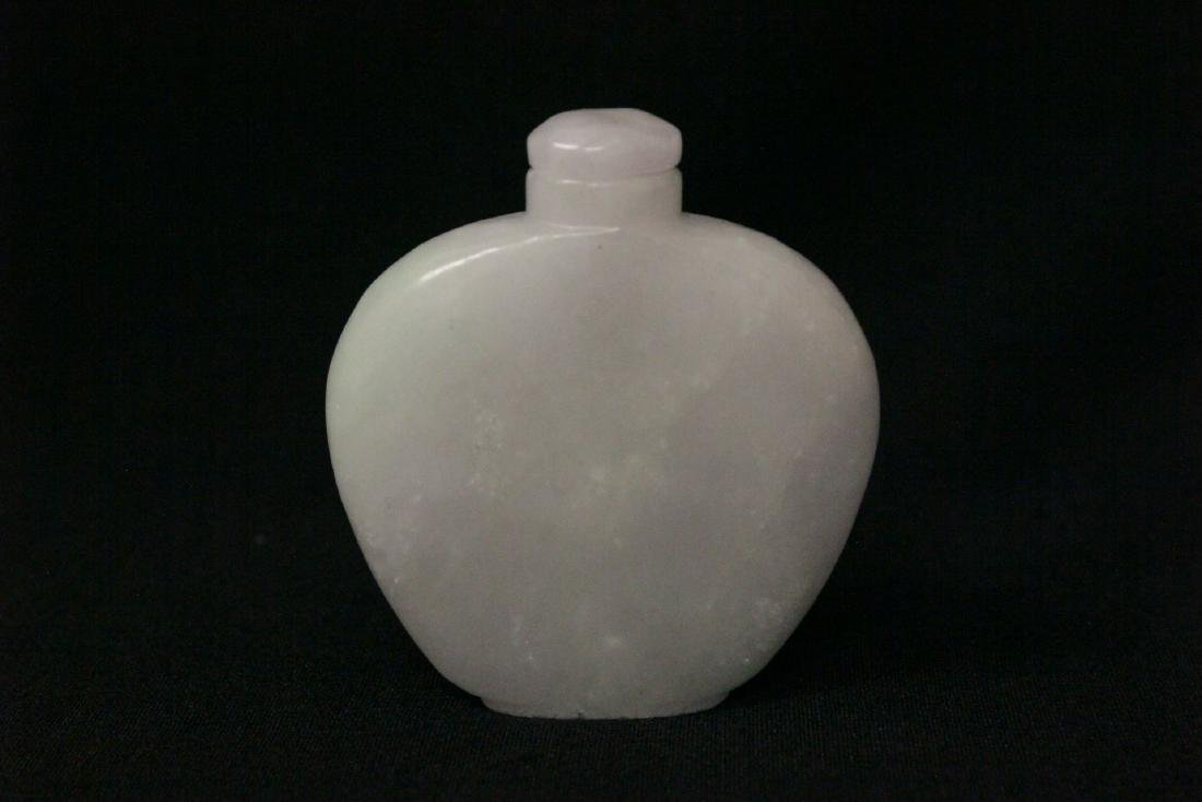 A fine Chinese white jade carved snuff bottle