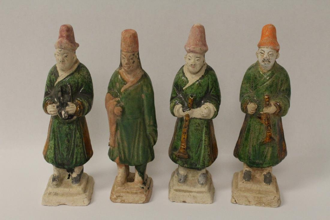 4 Ming style sancai glazed attendants