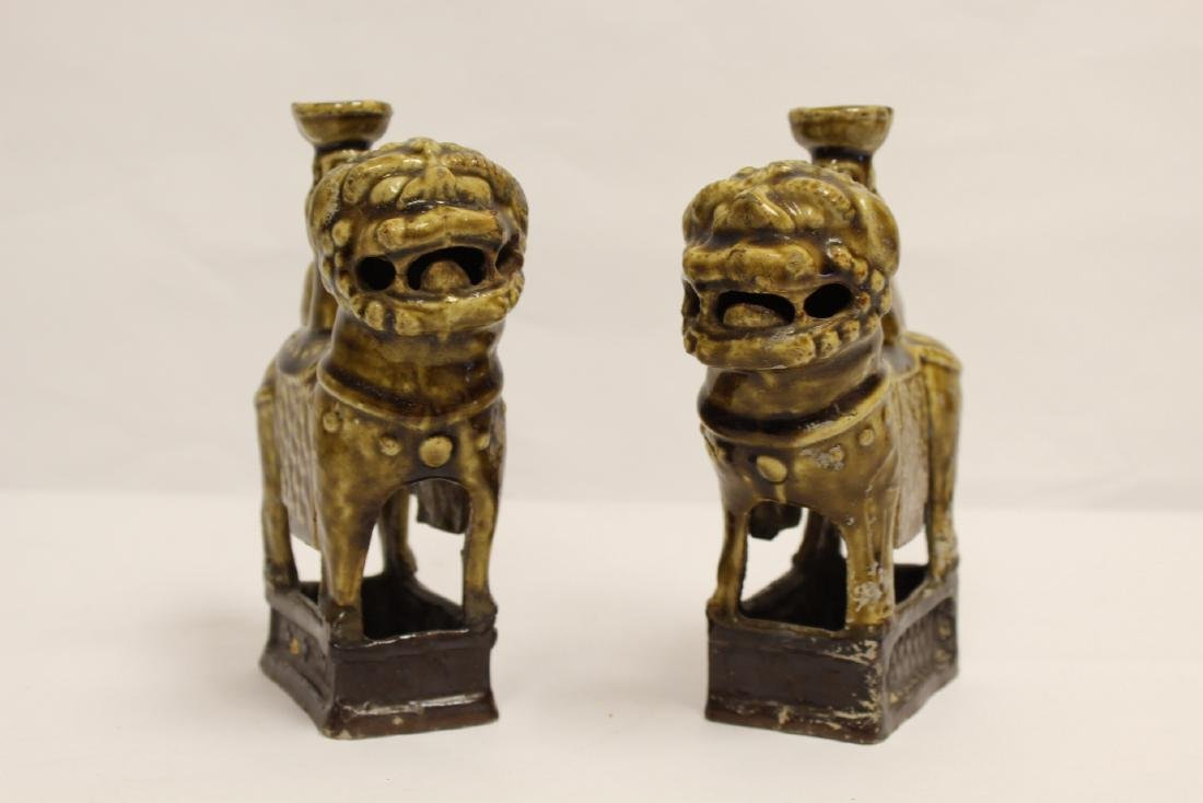 Pair brown glazed candle holders in animal motif