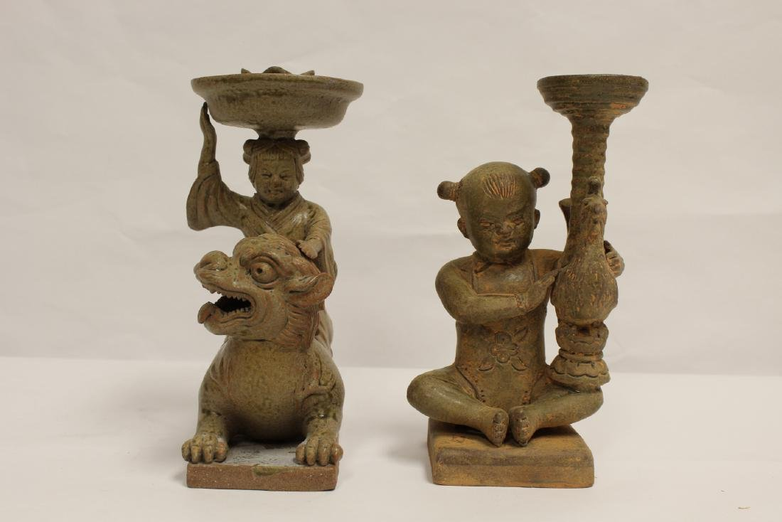 2 Han style pottery candle holders