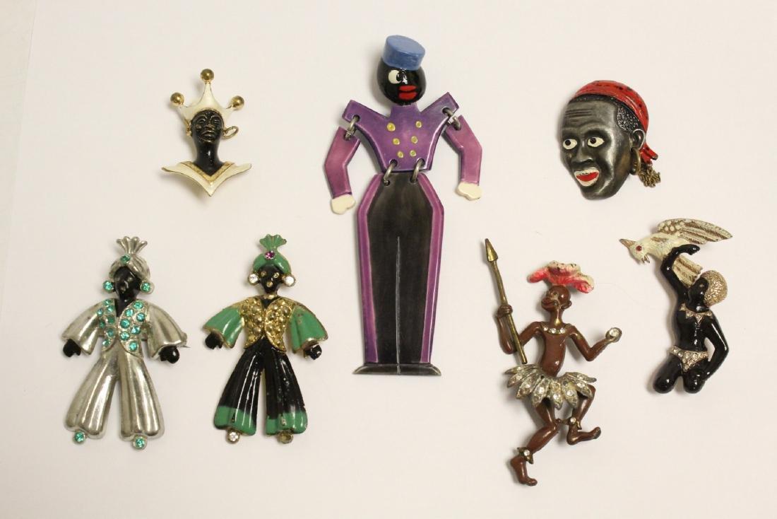 7 large black memorabilia brooches