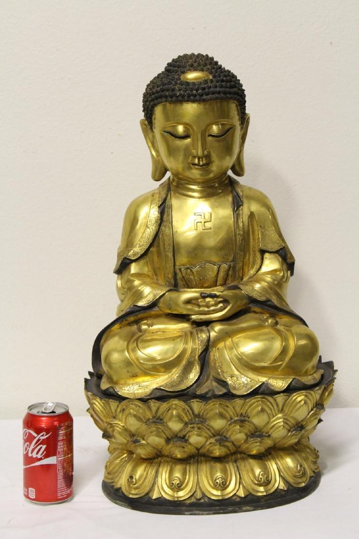A beautiful Chinese large gilt bronze seated Buddha