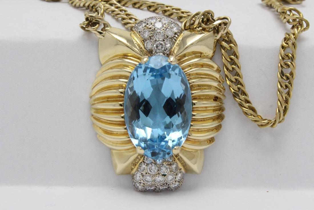 A beautiful 14K blue topaz diamond pendant