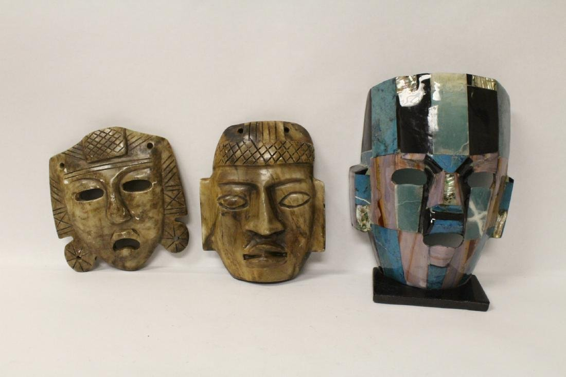 3 masks; 2 stone carved and one casted(?)
