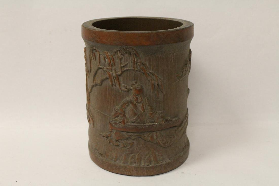 A well carved bamboo brush holder