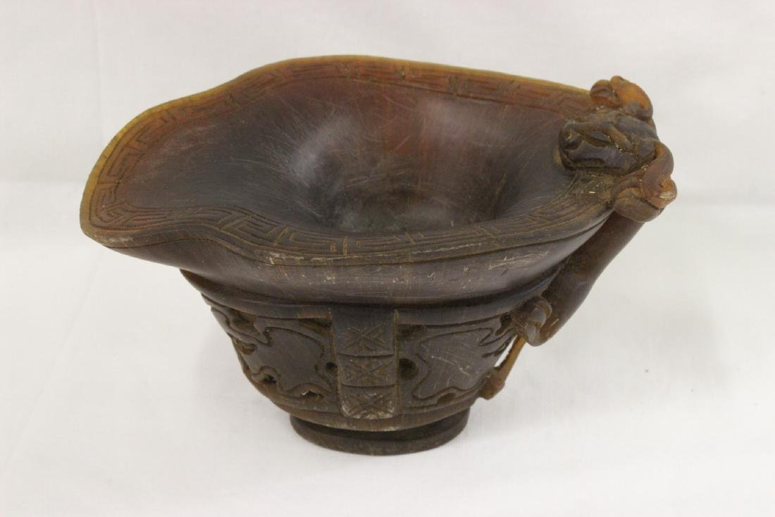 A horn style libation cup