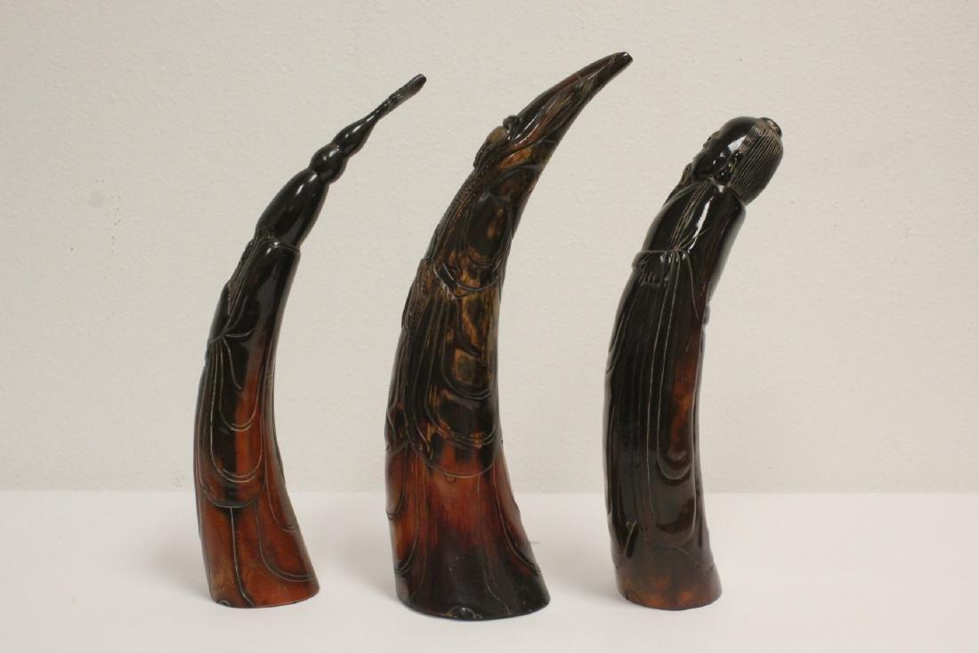 3 horn carved figures - 2