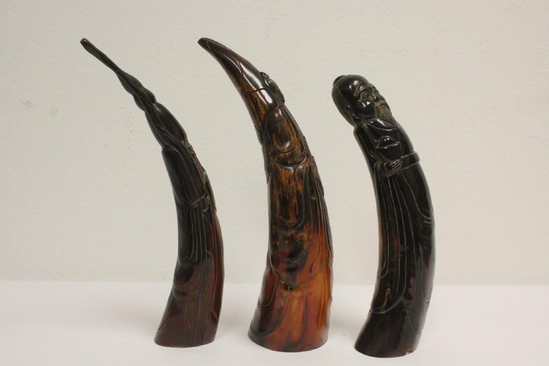 3 horn carved figures - 4