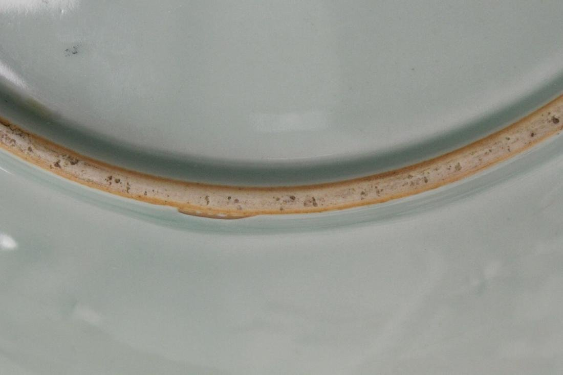 A large celadon porcelain charger - 10