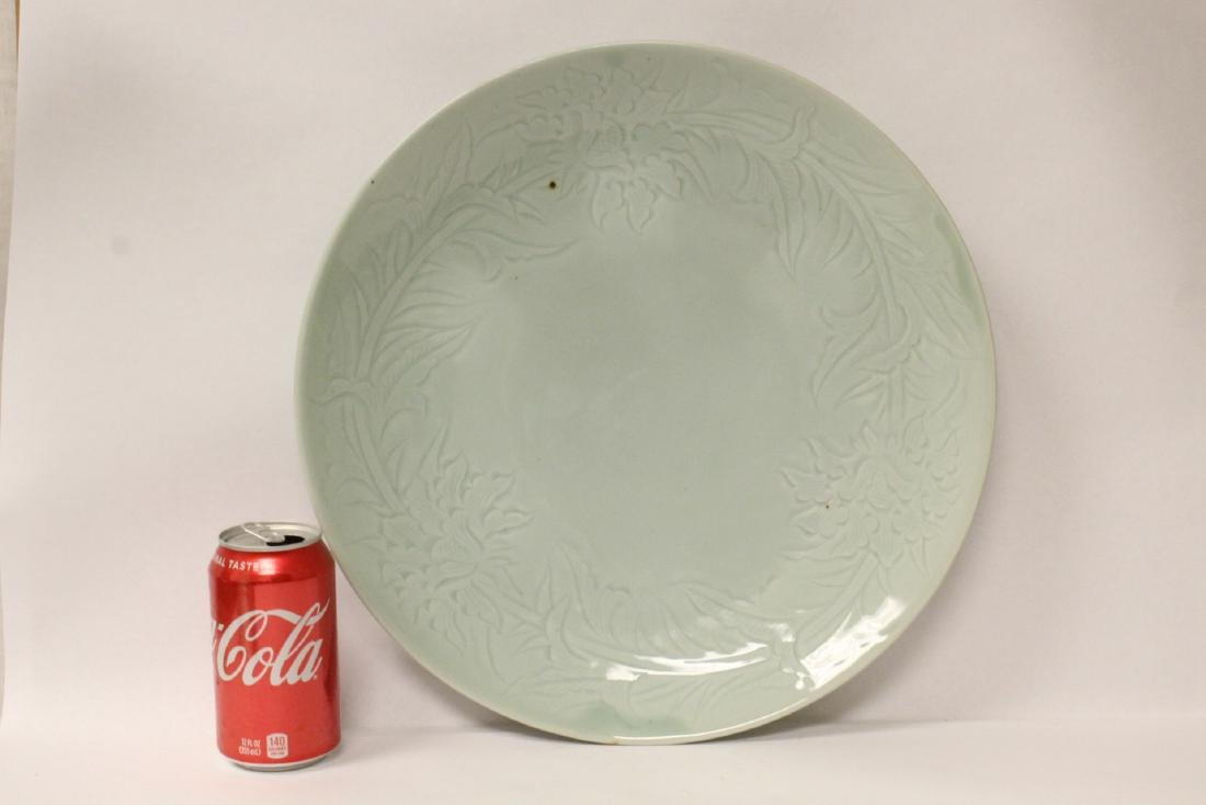 A large celadon porcelain charger