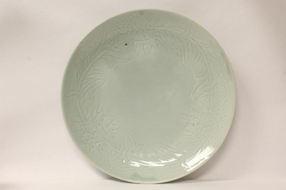 A large celadon porcelain charger - 2