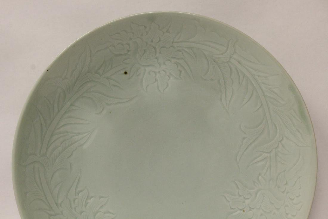 A large celadon porcelain charger - 4