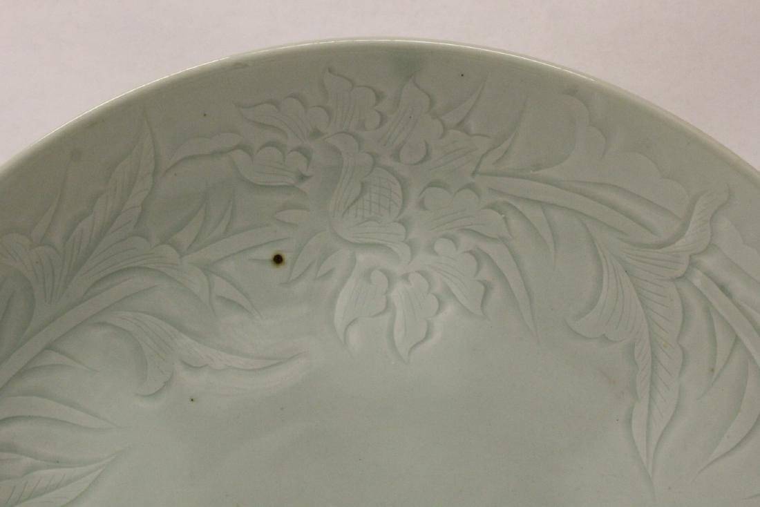 A large celadon porcelain charger - 5