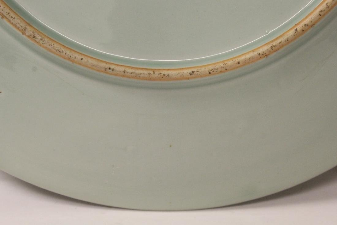 A large celadon porcelain charger - 9