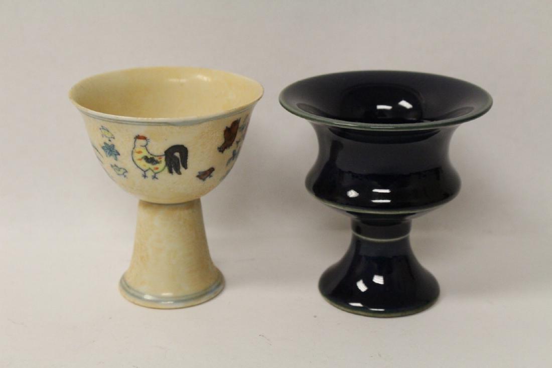 A blue glazed stem bowl and a wucai stem bowl
