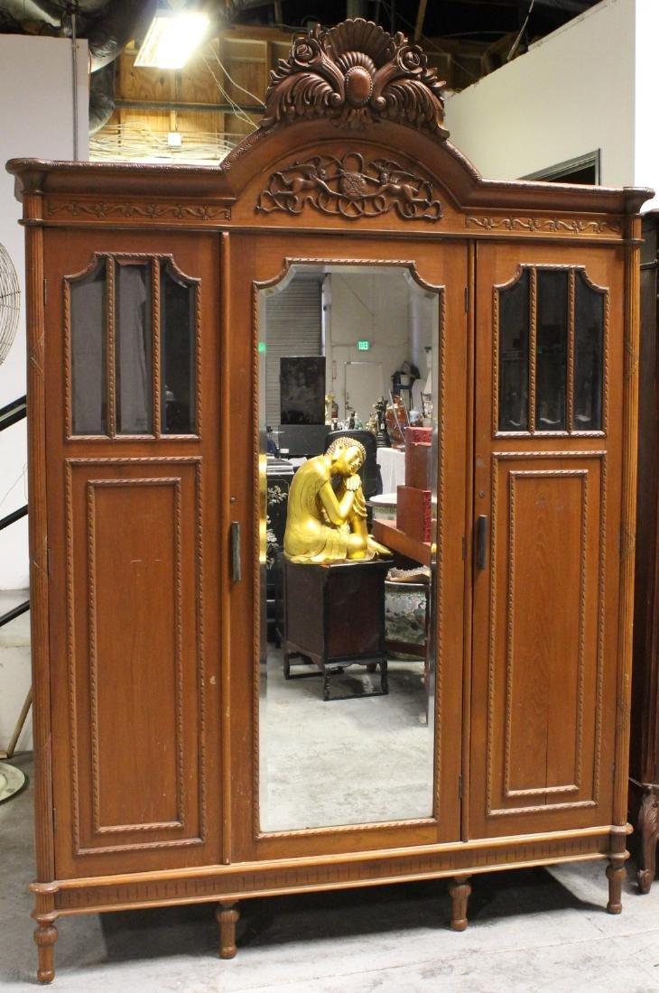 A very fancy Victorian mahogany armoire