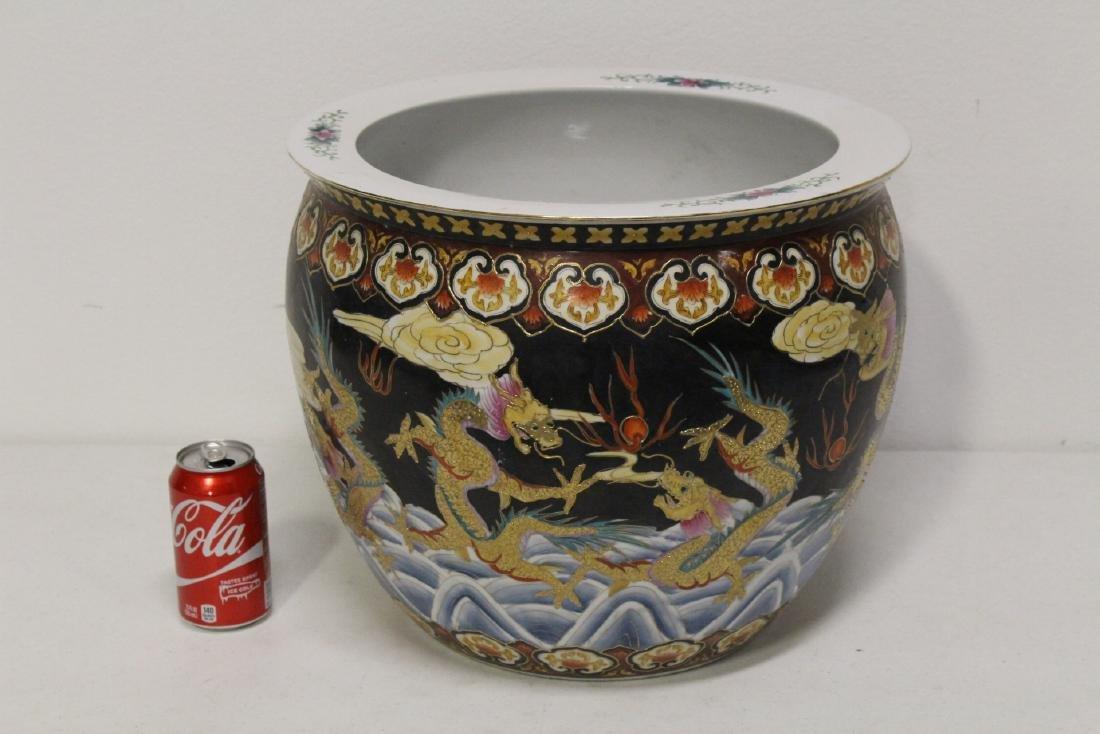 Black background famille rose fish bowl