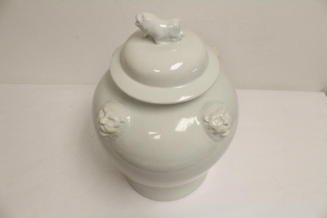 A large Chinese white porcelain covered jar with brass - 10
