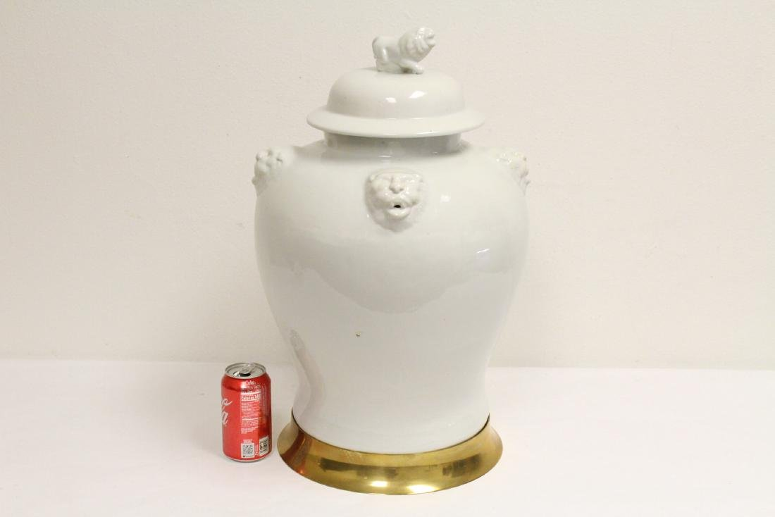 A large Chinese white porcelain covered jar with brass