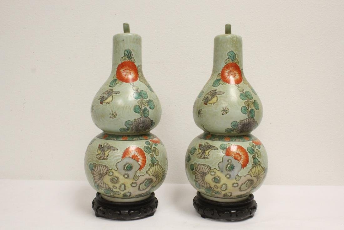 Pair famille rose porcelain gourds with stand