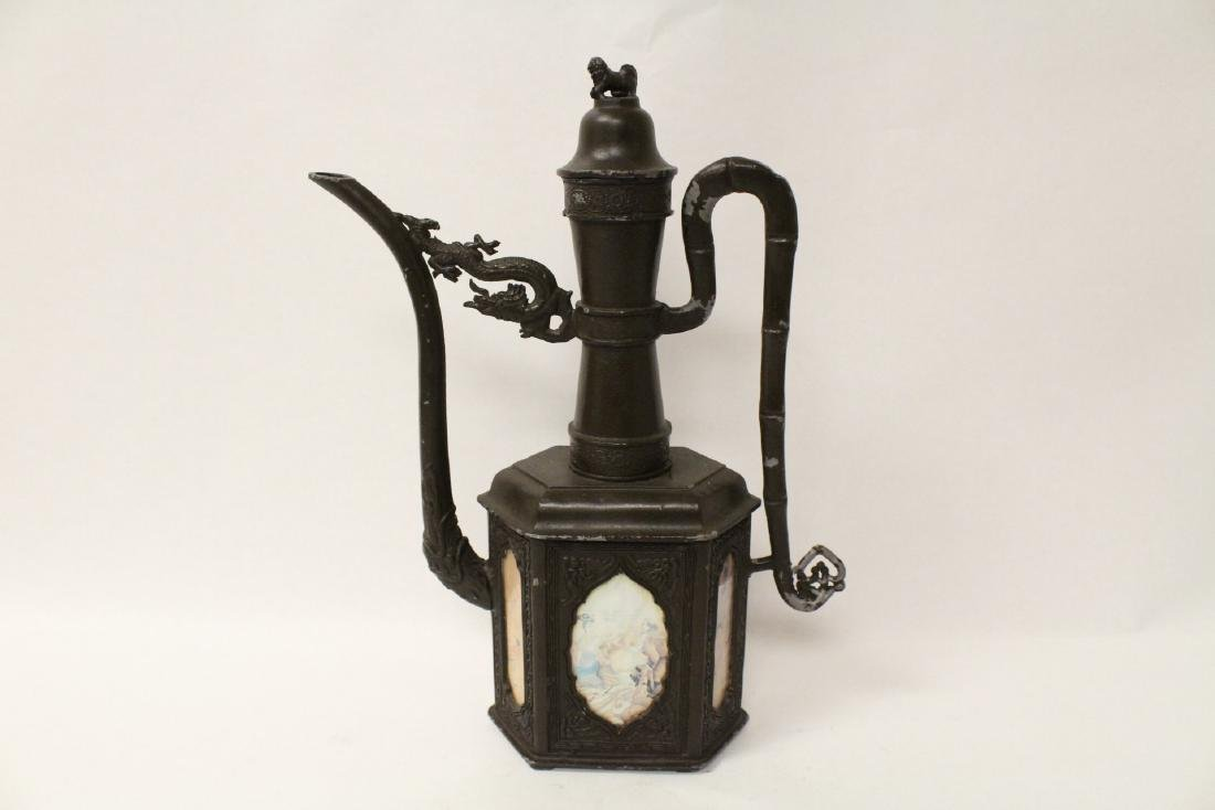 A pewter teapot