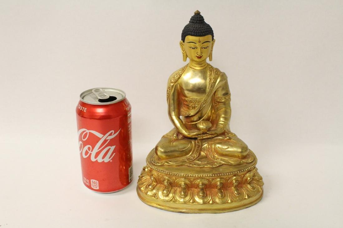 A gilt bronze sculpture of seated Buddha - 2